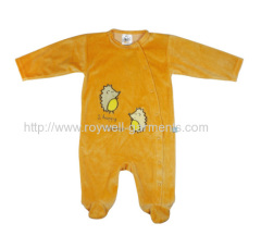 On the front chest with attached fabric patch back inside baby romper
