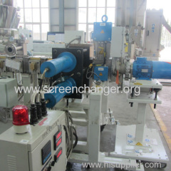Double piston continuous screen changer for plastic extrusion machine