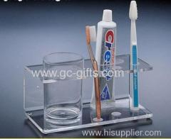 Clear acrylic toothbrush and tootpaste display rack