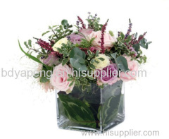 Clear glass vase with flower