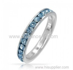 Fashion band ring with blue topaz element