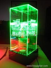 Organic glass base around LED green light product display packaging box