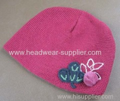 WOOLEN BABY HAT WITH HAND CROCHET FLOWER DECORATION