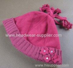 FLEECE HAT WITH KNITTED TURNUP AND FLOWER DECORATION