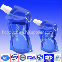 Self-standing and can be handled shaped pouch with spout for water