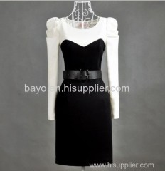 Women in black and white photograph goes all out hubble-bubble sleeve slimming long-sleeved dress