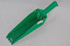 Plastic gutter scoop .