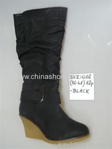 Long winter boots with wedge sole