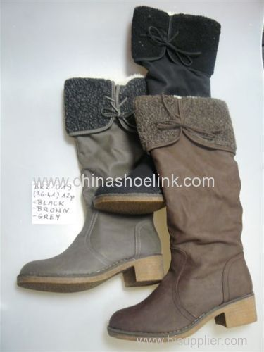Long winter boots with flat TPR sole made in China