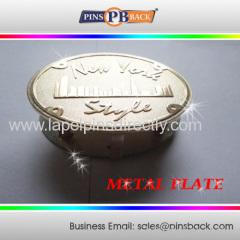Die struck metal plate badge