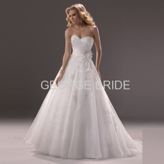 GEORGE BRIDE strapless Organza ballgown with asymmetrical wrap and sash detail
