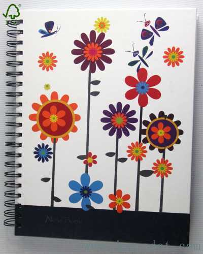 colored spiral notebook with flower and butterfly