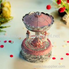PINK POLYRESIN CAROUSEL WIND UP MUSIC BOX