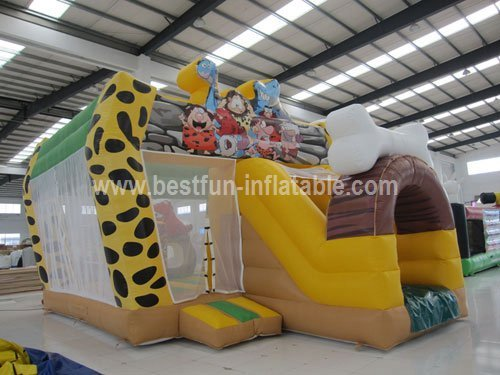 The Stone Age Inflatable Castle with Slide