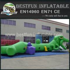 Green dinosaur inflatable tunnel