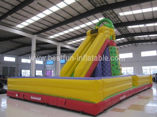 Inflatable slide climbing rock wall