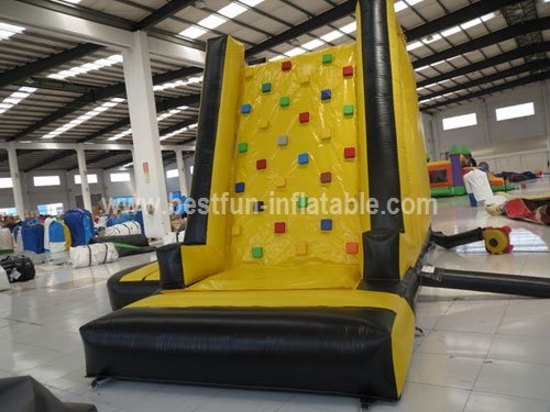 Inflatable tower climbing wall with slide