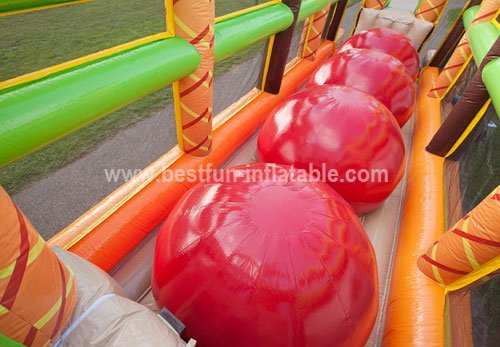 Inflatable wipe out ball obstacle course