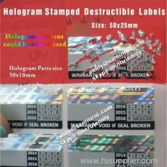 Holographic strip embossed destructive labels