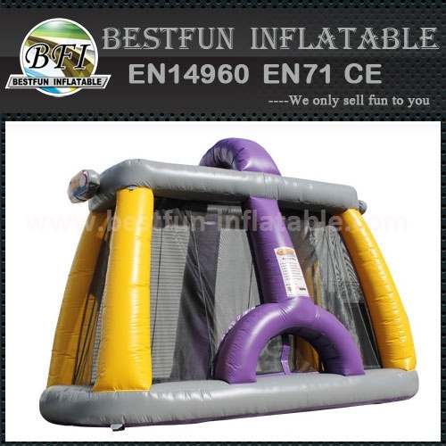 Backyard inflatable bounce with cannons