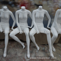 white sitting female mannequins