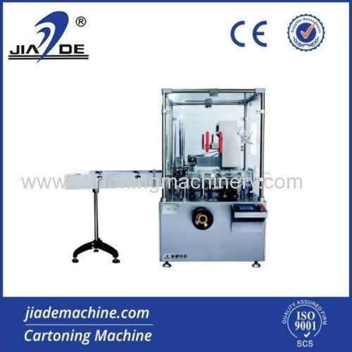 Automatic tube cartoning machine