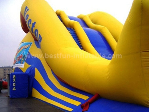 Inflatable climbing wall with slide