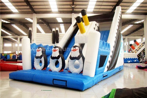 Inflatable madagascar penguin slide