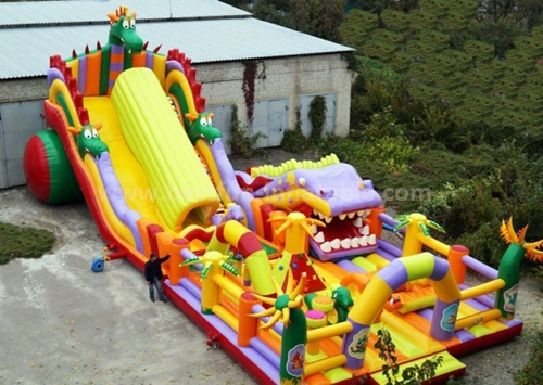 Inflatable obstacle course slide