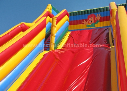 Inflatable slide with arch