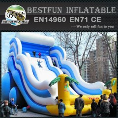 Inflatable ocean wave slide
