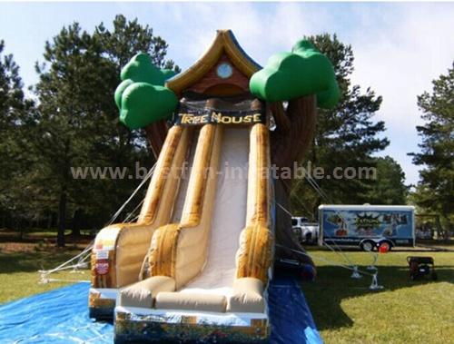 Tree house inflatable slide