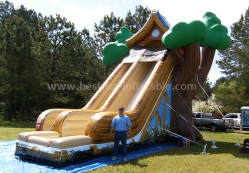 Tree house inflatable slide