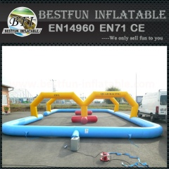 Curved inflatable tumble track