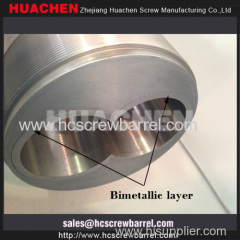 Bimetallic parallel twin screw barrel