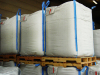 Dry bulk transporting packaging