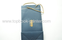 gold stamping ivory board paper clothing packaging bag with yellow cotton ropes