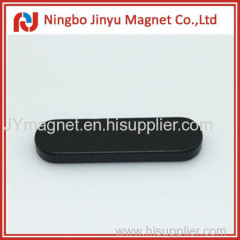 Alien shaped permanent magnet with epoxy coat