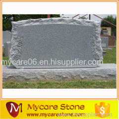 Scallop and shellrock tombstone
