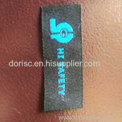 fire retardant woven label for no-burn fabric fire gard spray