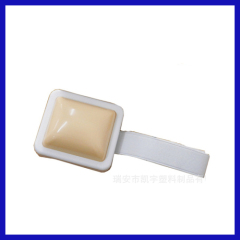 White Plastic injection practice pad for nurse to practice the injection