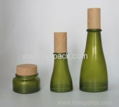 olive green glass jar and lotion bottle