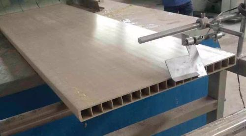 Wood plastic composite door production line