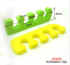 geen and yellow five fingers toe separator