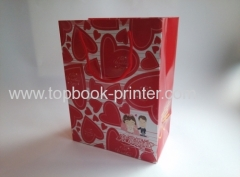 Gloss laminated art paper wedding gift packaging bag with red cotton rope