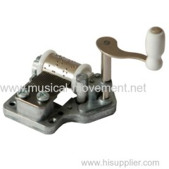 BIDIRECTIONAL HAND WOUND MUSIC BOX MOVEMENT