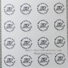 Small circular Diameter 10mm on the electronics Destructible Self-Adhesive crumblin warranty sticker.