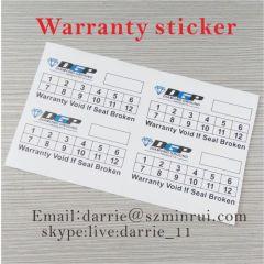 Custom 2.5x5centimeter stickers printed black and green on white eggshell vinyl of the free design warranty sticker