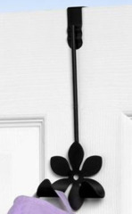 Clothes hanger for over the door black color flower shaped
