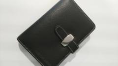 غطاء مصنوع من الجلد الأسود ملزمة سلك مذكرات أو دفتر الطباعة على مطالب